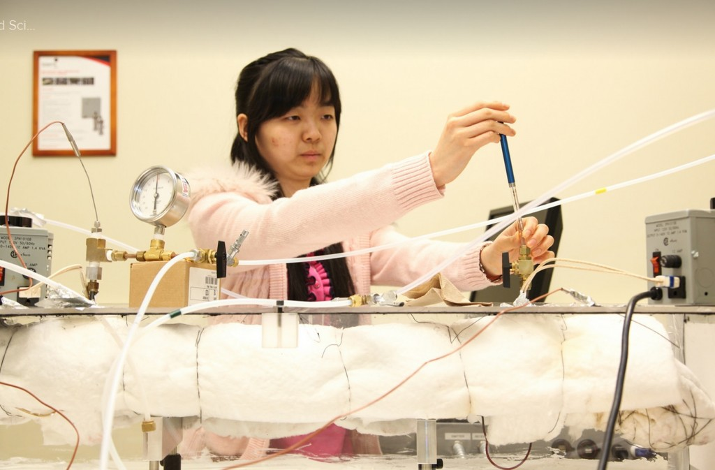 Yuhui Rachel Song performing Tera-Hertz spectroscopy experiments
